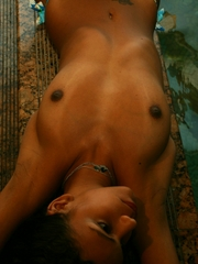 Polliana takes off her blue bikini, showing off her beautiful golden-brown, Brazilian skin and fine round tits and ass, before taking a dip in a dark swimming pool.