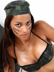 Polliana glistening sexy as ever as a soldier girl in camouflage bikini and panties, grease smudges, and thigh-high black boots.