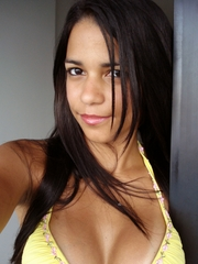 Latina Polliana's tits pop out of low cut yellow top, and her curvy Brazilian ass looks inviting as ever in pink athletics panties.